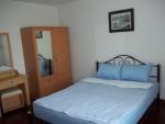 Vakantiehuis in Sportvillage slaapkamer.JPG